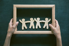 Wooden men holding hands royalty free stock image