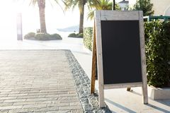 Sandwich Board at the street stock images