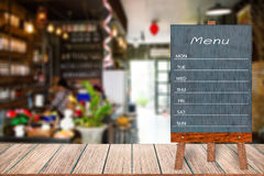 Wooden menu display sign, Frame restaurant message board on wooden table, Blurred image background. Wooden menu display sign, Frame restaurant message board on royalty free stock image