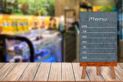 Wooden menu display sign, Frame restaurant message board on wooden table, Blurred image background. Wooden menu display sign, Frame restaurant message board on royalty free stock photos