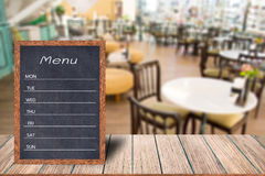 Wooden menu display sign, Frame restaurant message board on wooden table, Blurred image background. Template mock up for adding your design and leave space royalty free stock images