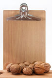 Wooden message board and nuts Royalty Free Stock Images