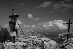 Wooden and metal cross on mountain summit Stock Photography