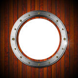 Wooden and Metallic Porthole Royalty Free Stock Image