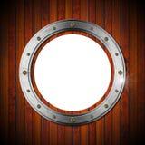 Wooden and Metallic Porthole Royalty Free Stock Image