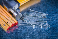 Wooden meter stainless nails and claw hammer on Stock Image