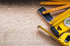 Wooden meter tape measure construction level and Royalty Free Stock Photo