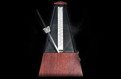 Wooden metronome Stock Photo