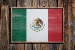 Wooden Mexico flag. 3d rendering of Mexico flag on a wooden frame over a planks wall Stock Image