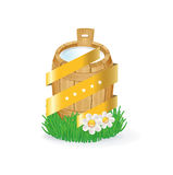 Wooden milk bucket in grass with quality golden ribbon concept Royalty Free Stock Photos