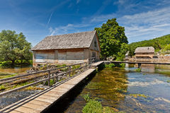 Wooden mill houses above the lake Stock Images