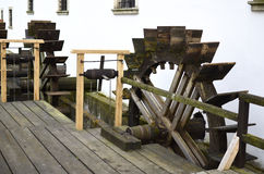 Wooden mill water wheels Stock Images
