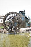 Wooden mill wheel. Beside the country cottage Royalty Free Stock Images