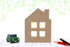 Wooden miniature model of house. On blueprints, construction plan Stock Image