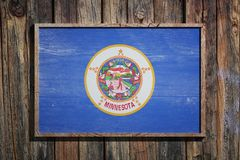 Wooden Minnesota flag. 3d rendering of a Minnesota State USA flag on a wooden frame and a wood wall Royalty Free Stock Photos