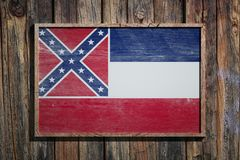 Wooden Mississippi flag. 3d rendering of a Mississippi State USA flag on a wooden frame and a wood wall Royalty Free Stock Photos