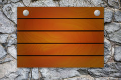 Wooden mock up board on stone background Royalty Free Stock Image
