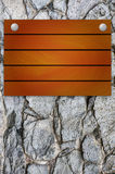 Wooden mock up board on stone background Royalty Free Stock Images