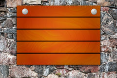 Wooden mock up board on stone background Royalty Free Stock Photo
