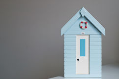 Wooden model beach hut. Royalty Free Stock Photography