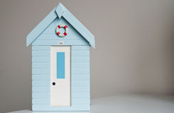 Wooden model beach hut. Royalty Free Stock Photos