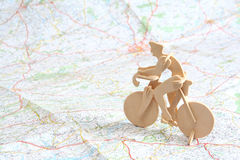 Wooden model of bicyclist on map Stock Photos