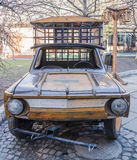 Wooden model car brand ZAZ with the lattice in the back for transportation of prisoners on the street Lviv, Ukraine Stock Photos