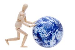 Wooden model dummy hand rolling globe Royalty Free Stock Photo