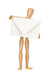 Wooden model dummy holding envelop Royalty Free Stock Photo