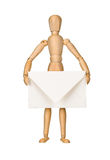 Wooden model dummy holding envelop Stock Photography