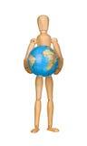 Wooden model dummy holding globe. Stock Images