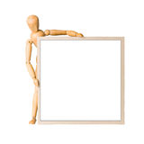 Wooden model dummy holding square cardboard frame Stock Photos