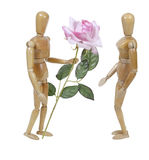 Wooden Model Giving Pink Rose Royalty Free Stock Image