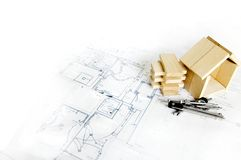 Wooden model of house and blueprints Stock Images