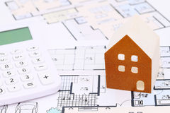 Wooden model of house on blueprints. Construction plan Royalty Free Stock Images