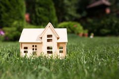 Wooden model of house on grass Royalty Free Stock Photo