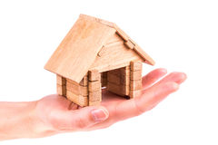 Wooden model house in a hand Royalty Free Stock Photo