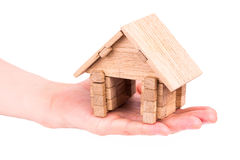Wooden model house in a hand Royalty Free Stock Image