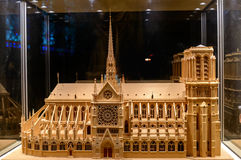 Wooden model of Notre Dame de Paris under glass dome side view Royalty Free Stock Photos