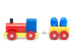 Wooden model railway with easter eggs on wagons Royalty Free Stock Photo