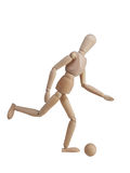 Wooden models playing football Stock Images