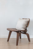 Wooden modern chair with pillow Royalty Free Stock Image