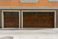 Wooden modern three car garage door Royalty Free Stock Photography