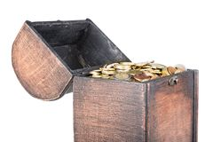 Wooden money chest filled with coins isolated at a white background Royalty Free Stock Photo