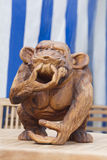 Wooden monkey carving Stock Photos
