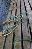 Wooden mooring. A part of wooden mooring with ropes on it Royalty Free Stock Photo