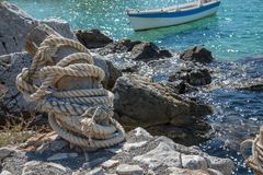 Wooden mooring bid. Mooring bid made of Wood with rope ideal for small fisherman`s small boat Stock Image