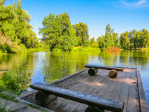 Wooden mooring on the forest lake Stock Photo