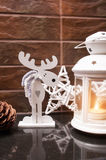 Wooden moose and candle Christmas decorations Royalty Free Stock Images