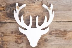 Wooden moose head on wooden background stock photography